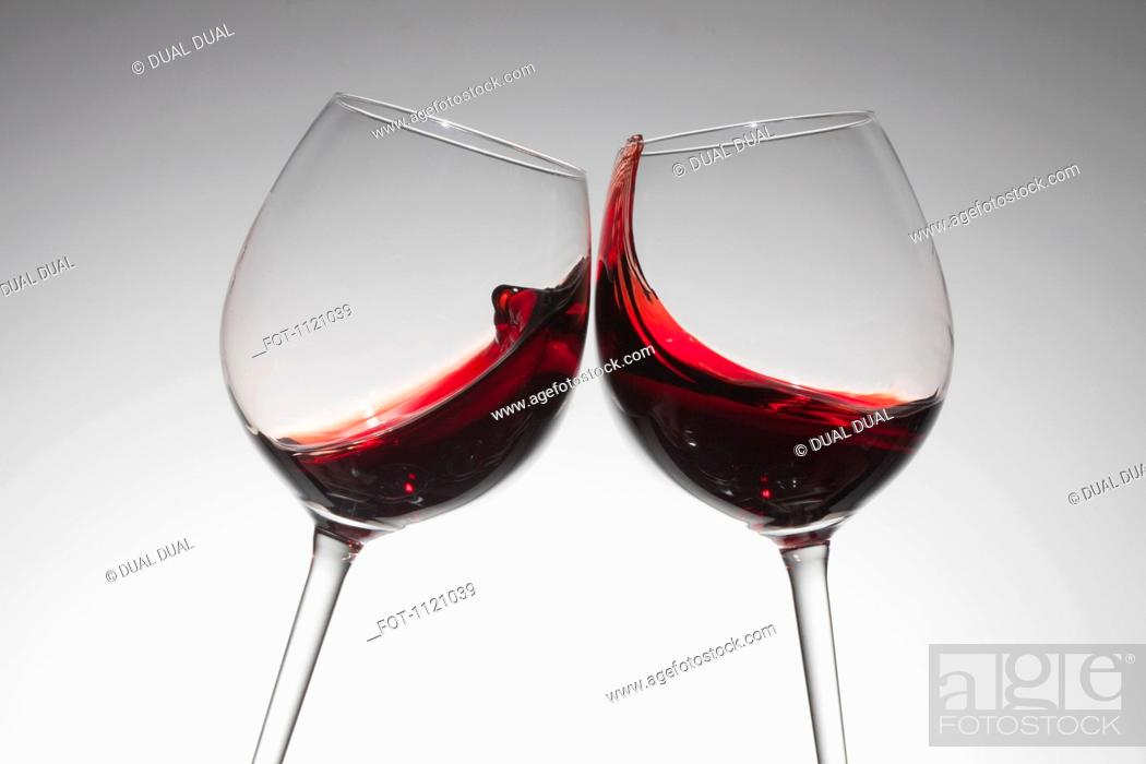 Stock Photo: Toasting with two glasses of red wine.