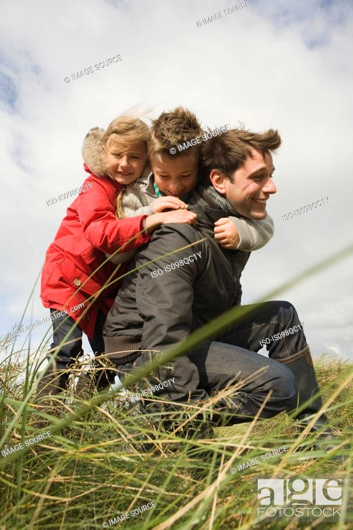 Stock Photo: Children and father outdoors.