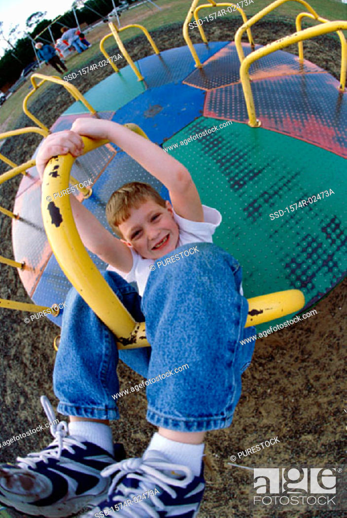 Stock Photo: Portrait of a boy on a merry-go-round.