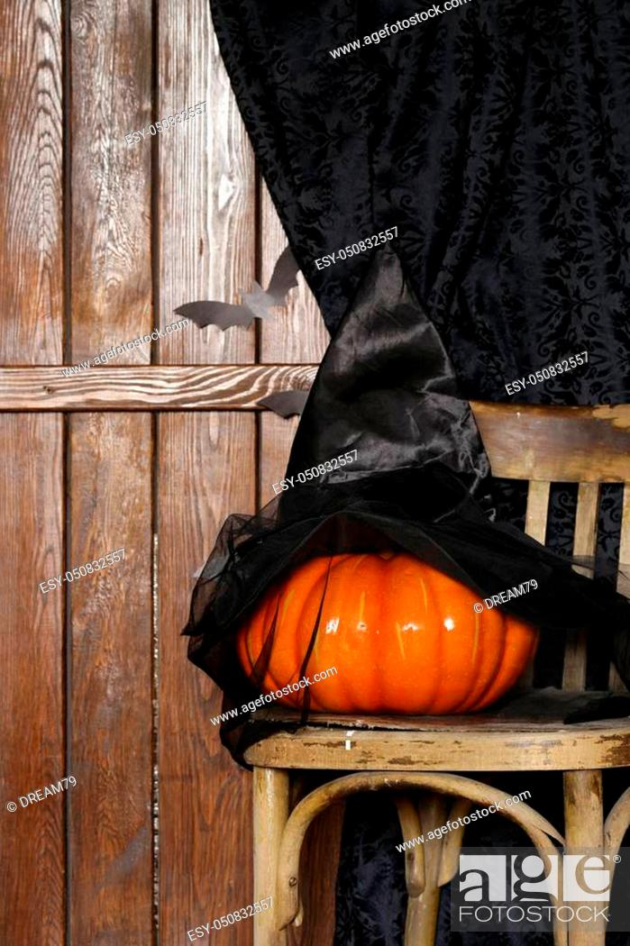 Stock Photo: decorations for Halloween holiday - an old chair, origami bats and pumpkin.