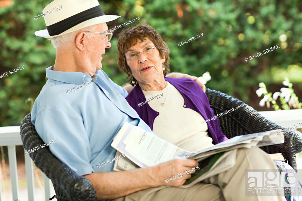 Stock Photo: Senior couple with newspaper.