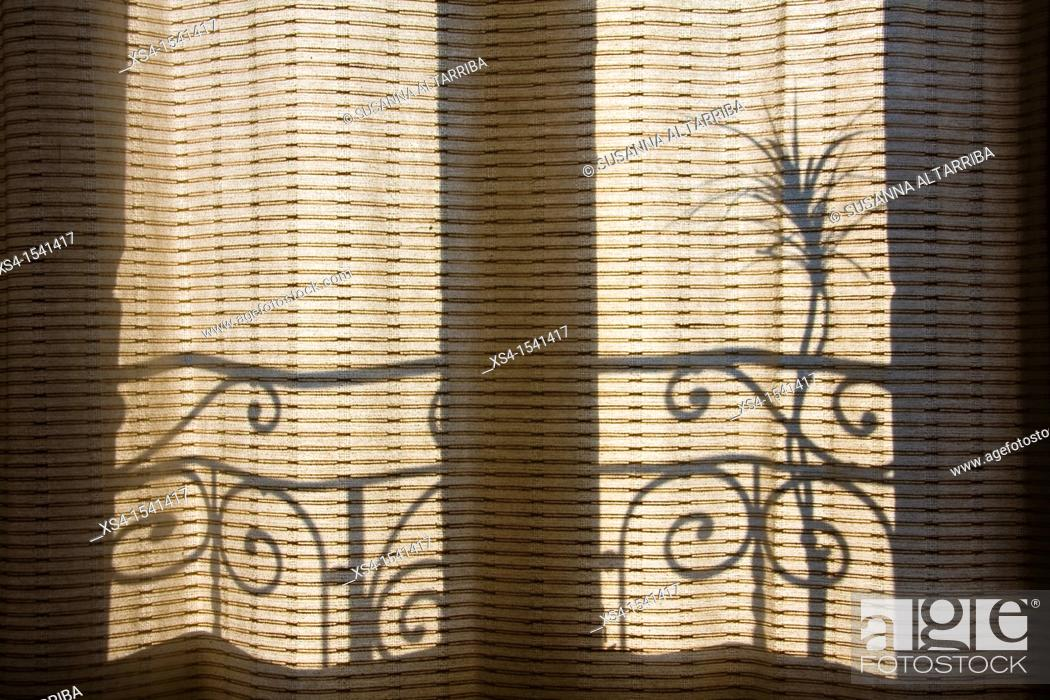 Stock Photo: shadows on the curtains.