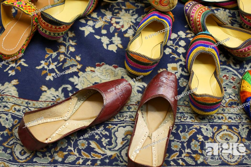 Stock Photo: Traditional footwear made by local artisans for sale at Jodhpur in Rajasthan, India.