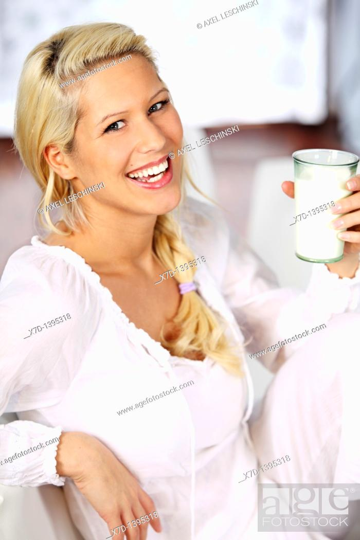 Stock Photo: woman drinking milk.