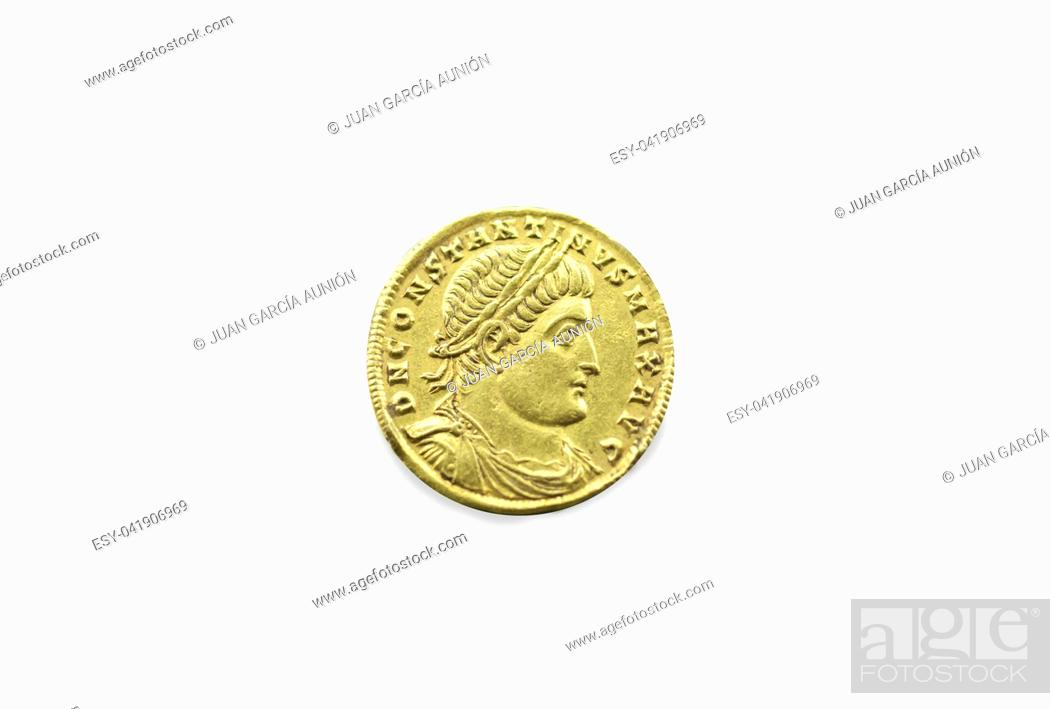 Stock Photo: Gold coin depicting the bust of Emperor Constantine the Great. Isolated over white.