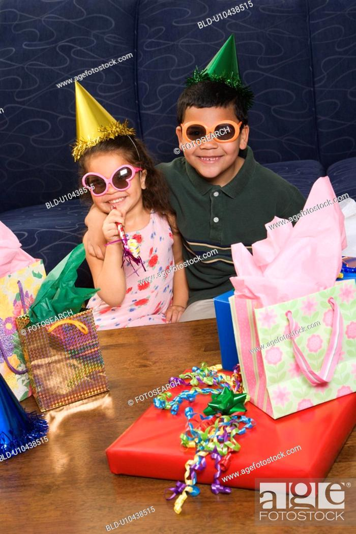 Stock Photo: Brother and sister wearing sunglasses.