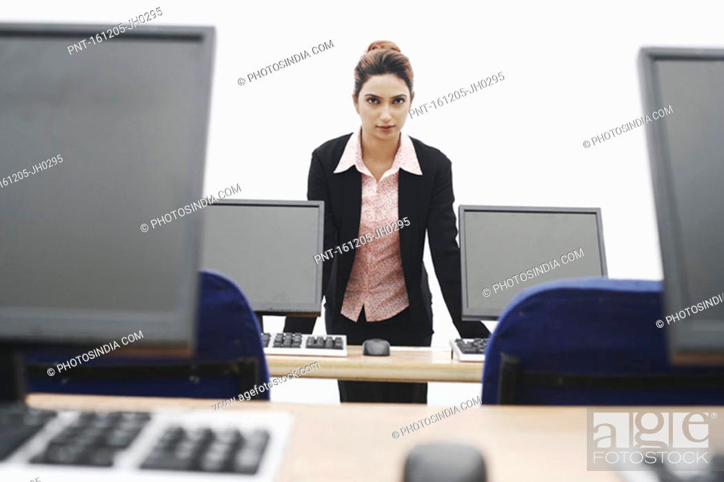 Stock Photo: Portrait of a businesswoman leaning against the table.