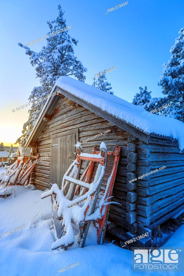 Stock Photo: Snow covered trees in extreme cold temperatures, Lapland, Sweden Sleds and small log shed, Lapland, Sweden.