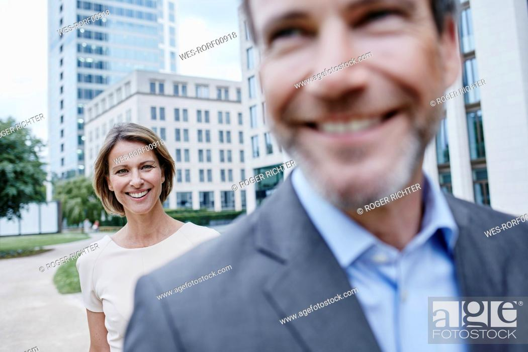 Stock Photo: Happy businesswoman and businessman outdoors.