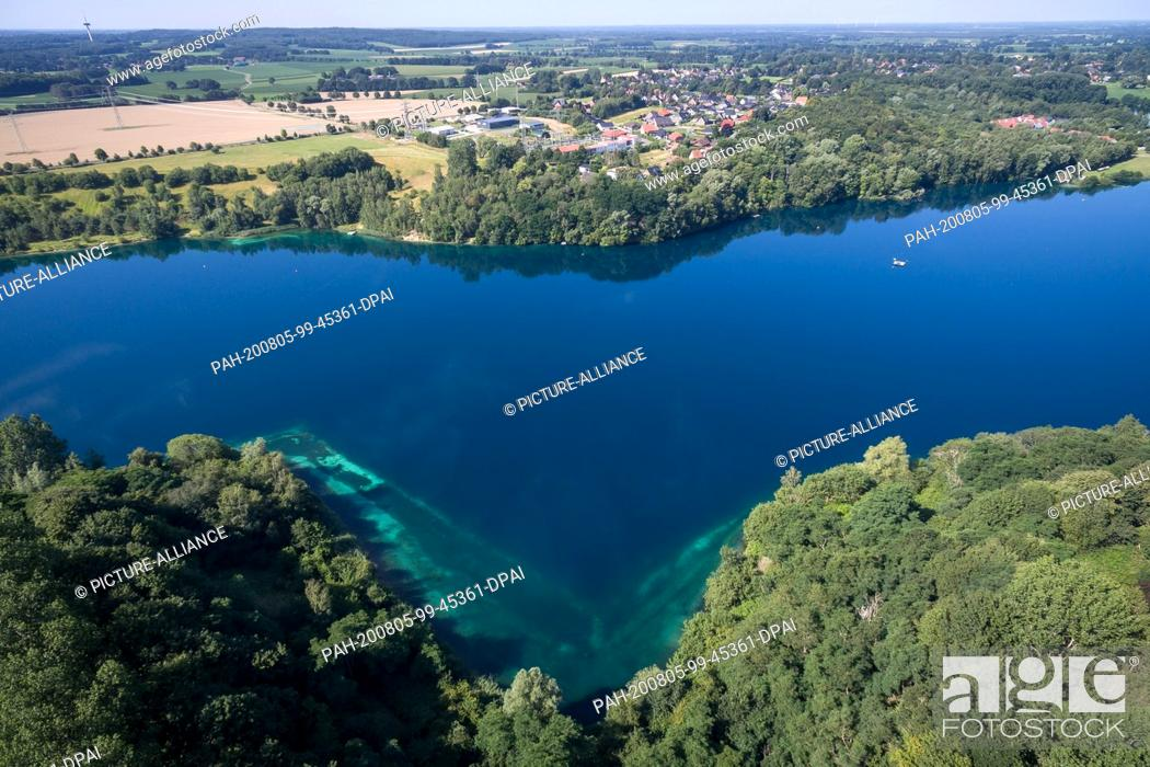 Stock Photo: 31 July 2020, Lower Saxony, Hemmoor: The chalk lake, taken with a drone. The lake in the district of Cuxhaven is also popular with divers nationwide.