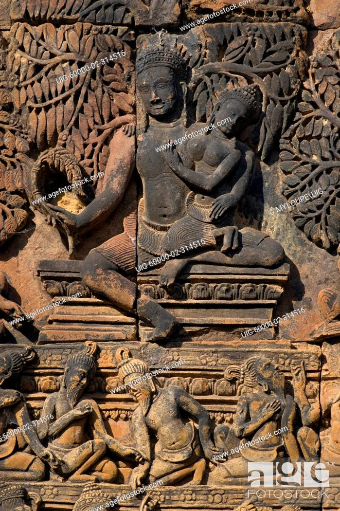 Stock Photo: Banteay Srei with bas relief in red sandstone showing Shiva & Parvati E pediment of S Library, 10th century Khmer architecture at Angkor Wat - Siem Reap.