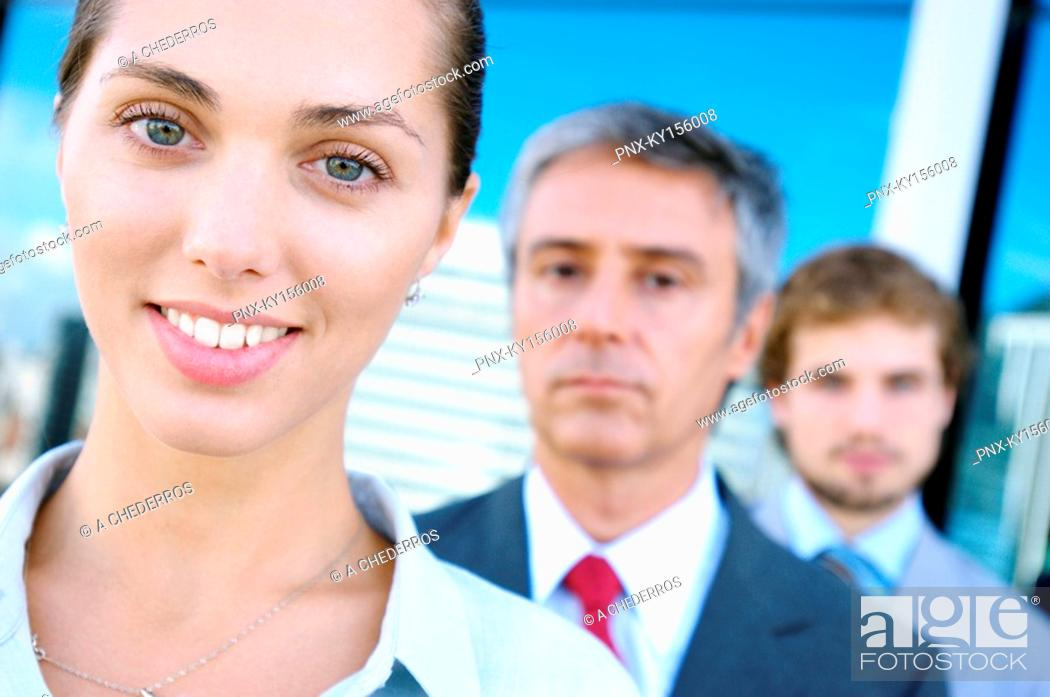 Stock Photo: Business people standing in row, smiling, portrait.