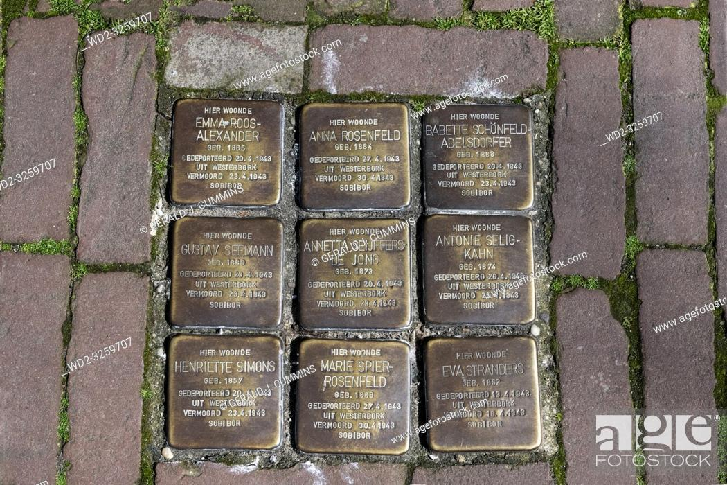 Stock Photo: Netherlands, Gouda, 2017, Stumbling stones, or stolpersteine are memorial brass plates placed into the pavement outside certain houses or deportation zones in.