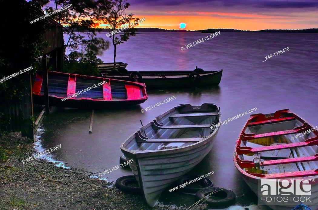 Stock Photo: Sunset over Lough Owel, with moored boats in the foreground, near Mullingar, County Westmeath, Ireland.