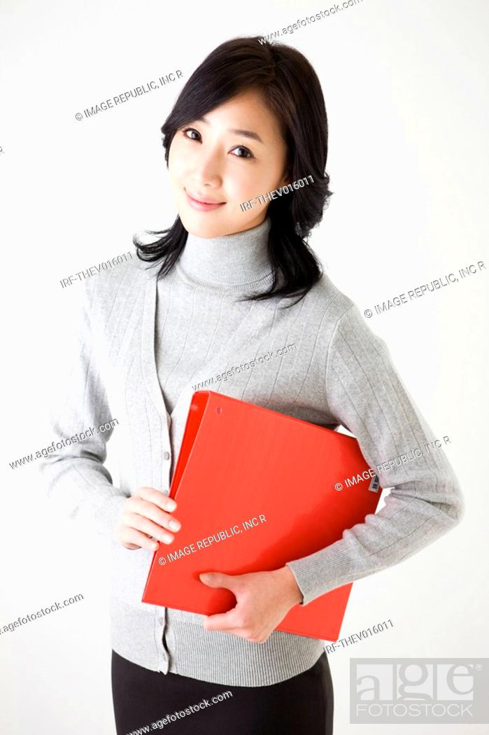 Stock Photo: businesswoman holding a profile.