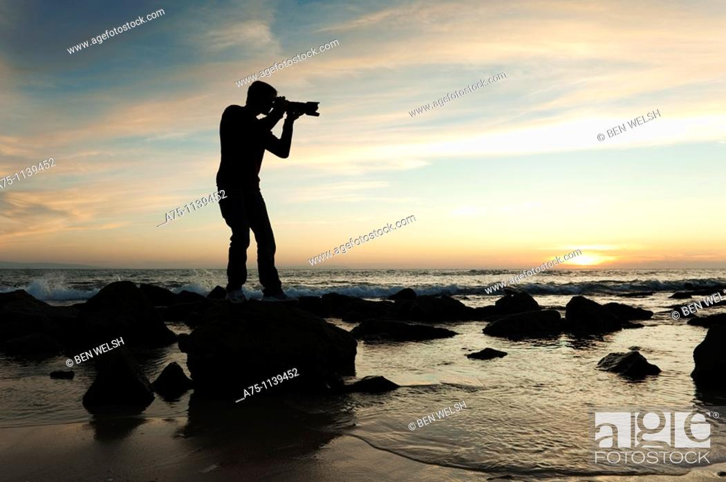 Stock Photo: Silhouette of photographer on the beach.