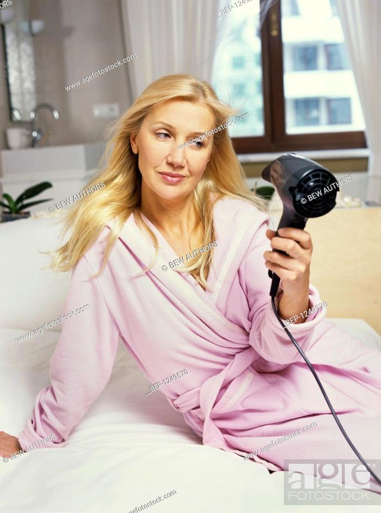 Woman in a dressing gown drying her hair, Stock Photo, Picture And ...