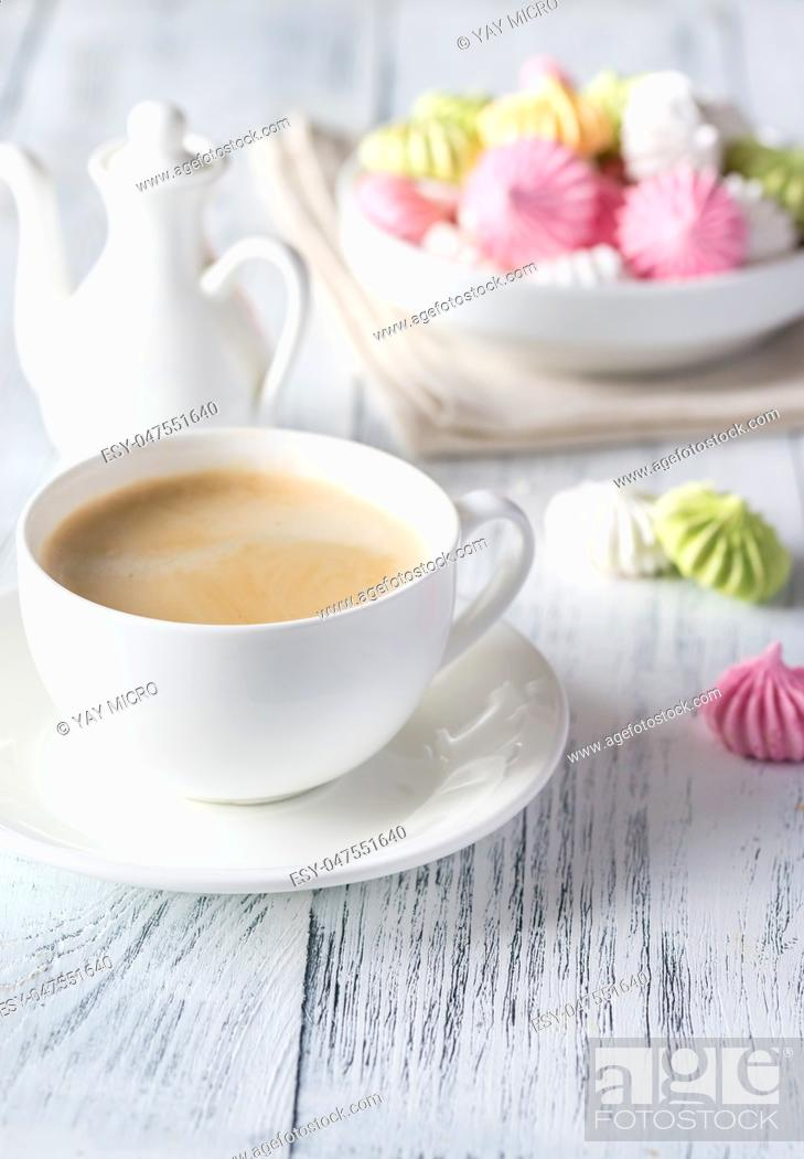 Stock Photo: Cup of coffee with colored meringues.