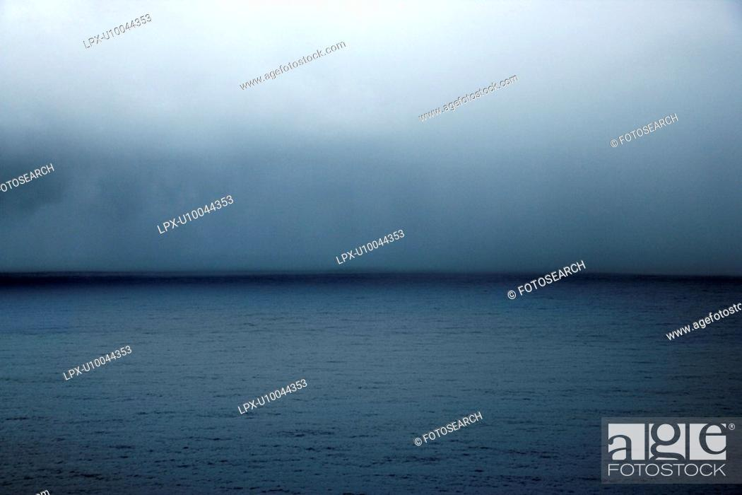 Stock Photo: Horizon of cloudy sky over the Pacific Ocean in Maui, Hawaii, USA.