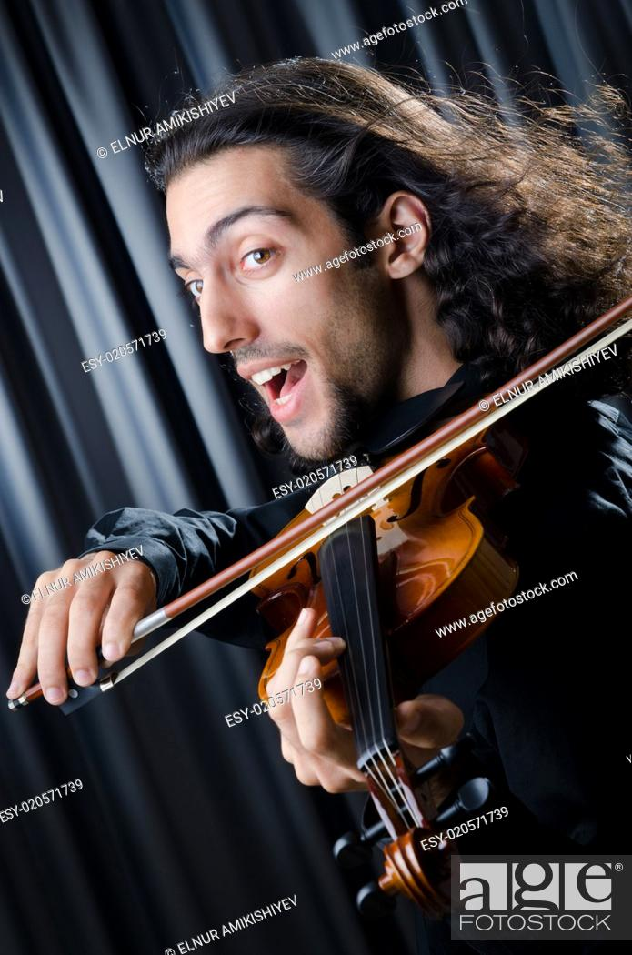 Stock Photo: Young violin player playing.