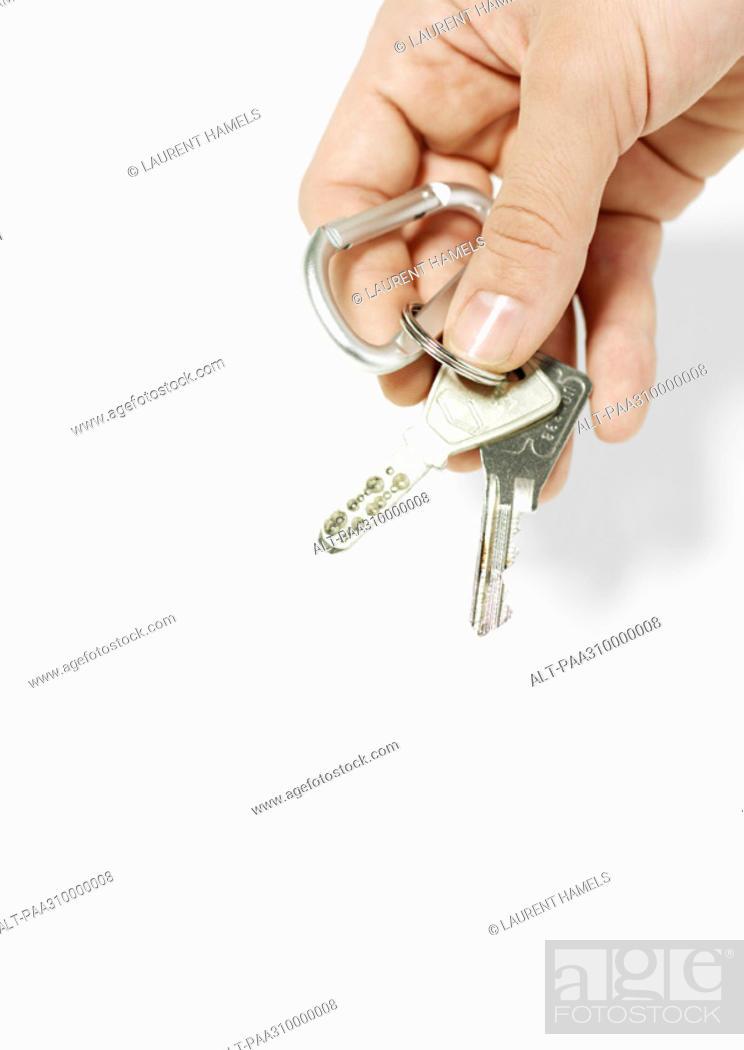 Stock Photo: Hand holding keys.