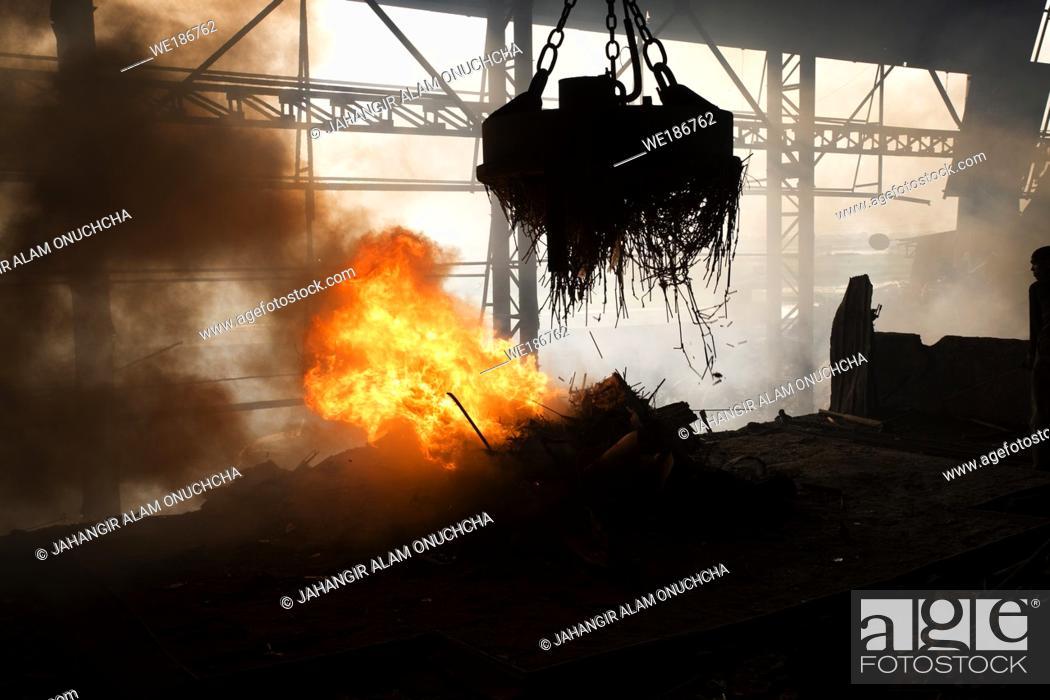 Stock Photo: Scrap steel melts down in an induction furnace at Demra, Dhaka, Bangladesh.