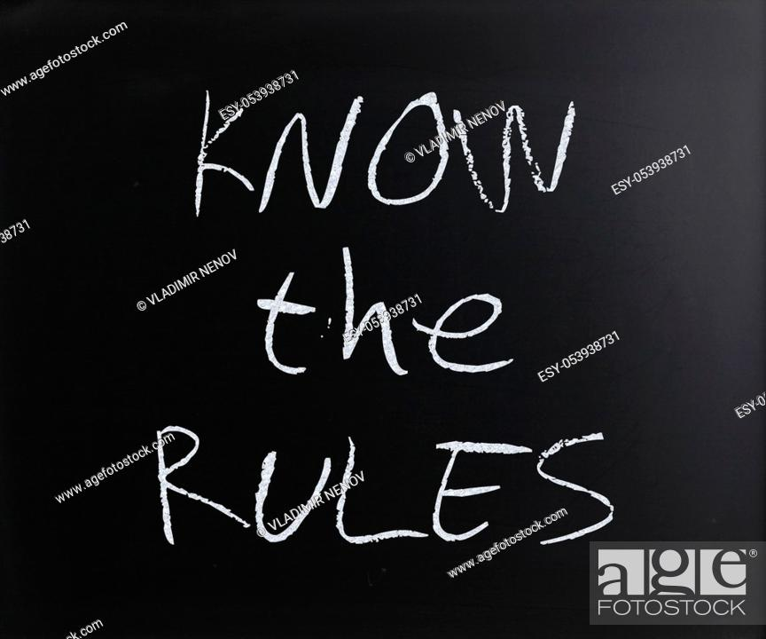 "Stock Photo: """"""""""Know the rules"""" handwritten with white chalk on a blackboard."