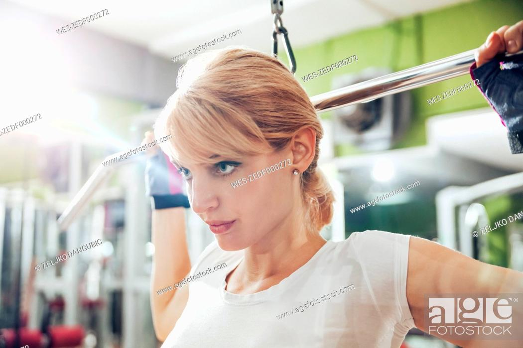 Stock Photo: Pregnant woman doing exercises in gym.