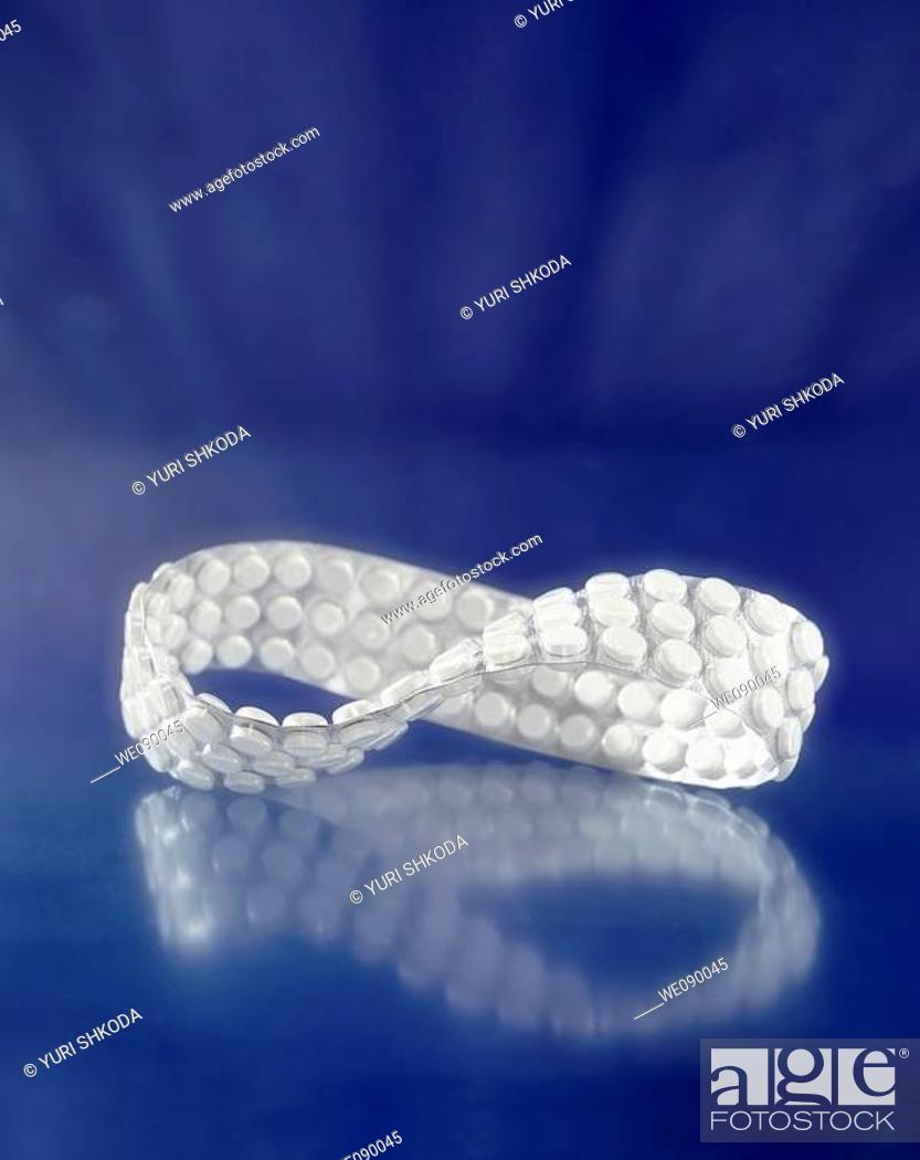 Stock Photo: Endless ribbon with pills.