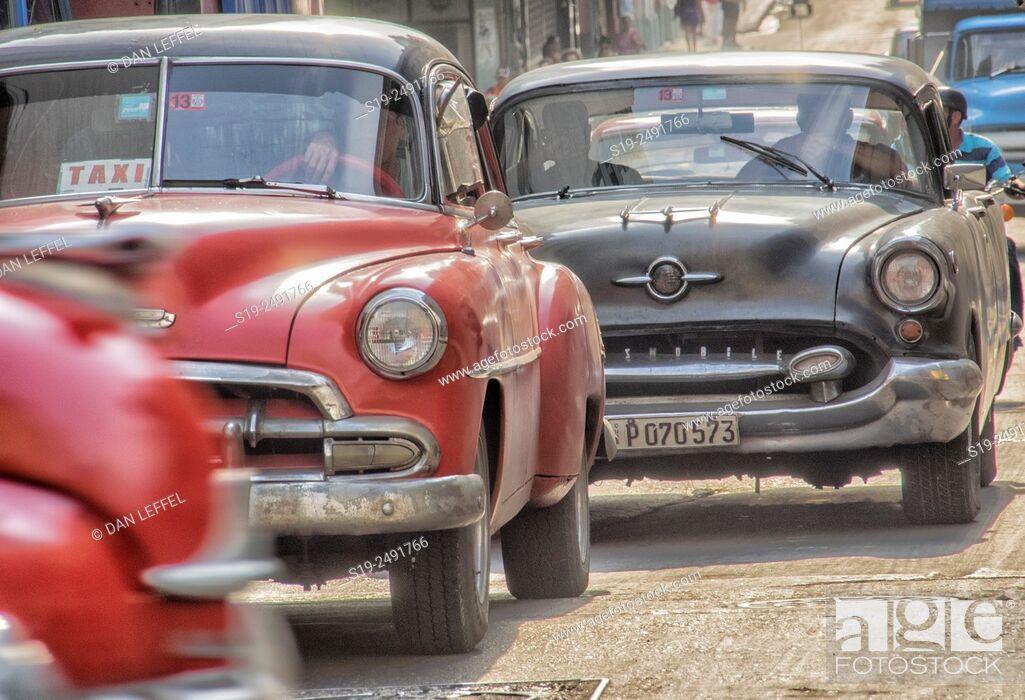 Stock Photo: Cuba, Havana, Vintage cars in traffic, taxi.