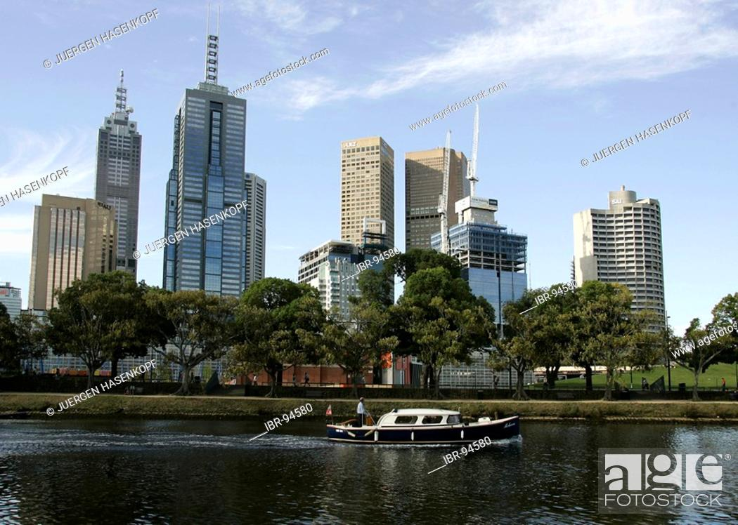 Stock Photo: Water taxi at the southbank promenade on the Yarra River with the city skyline in the background, Melbourne, Victoria, Australia.