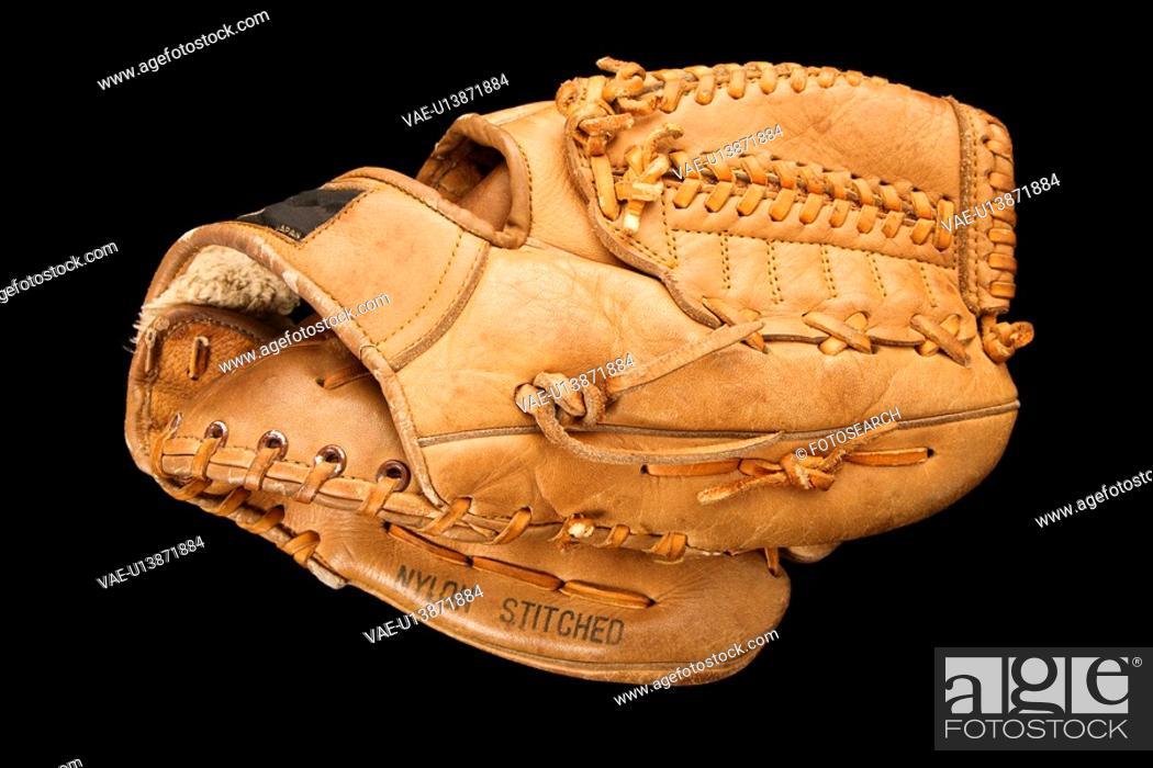 Stock Photo: Baseball glove on black.