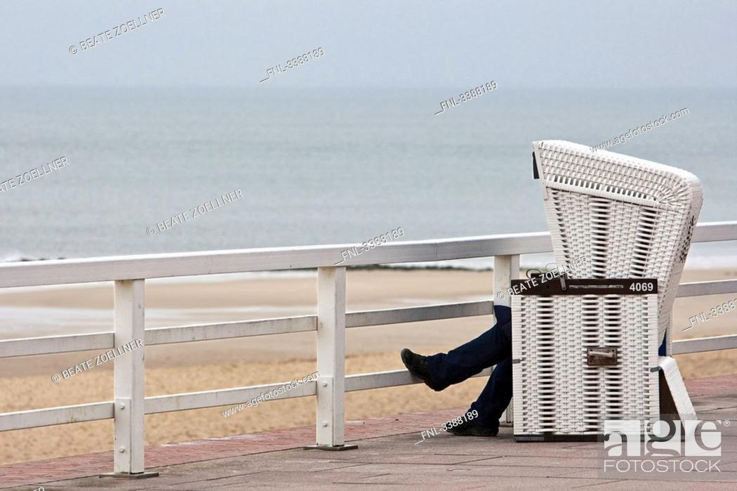 Person Sitting In Hooded Beach Chair On Waterside Promenade Westerland Sylt Germany Stock Photo Picture And Rights Managed Image Pic Fnl 3388189 Agefotostock