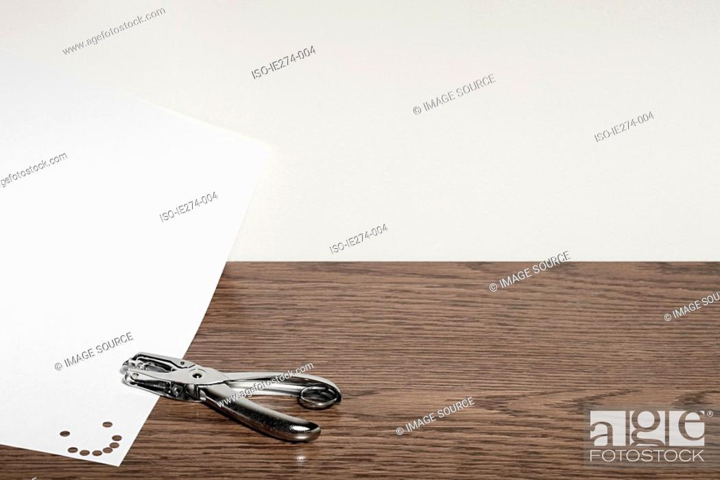 Stock Photo: Smiley face and hole punch.