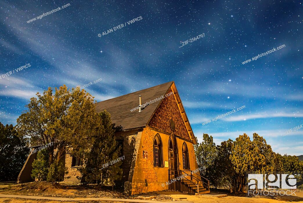 Stock Photo: This is a moonlit nightscape of the historic Hearst Church in Pinos Altos, New Mexico, at 7000 feet altitude (thus the name â. œHigh Pinesâ.