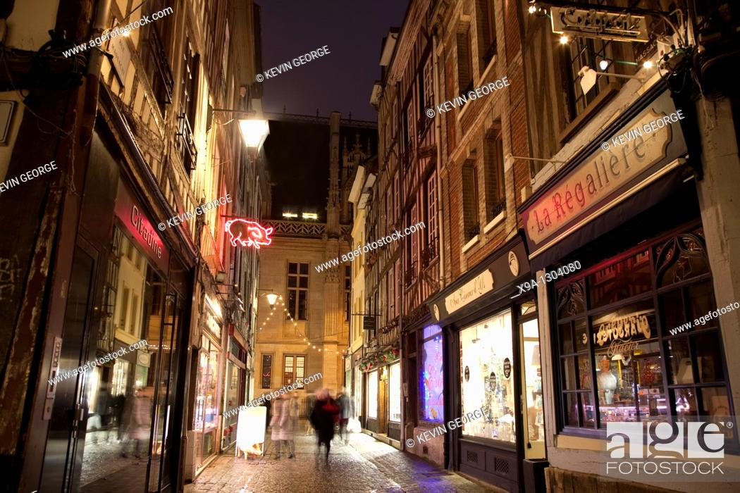 Stock Photo: Shop fronts illuminated at night in Thouret street, Rouen, Normandy, France.