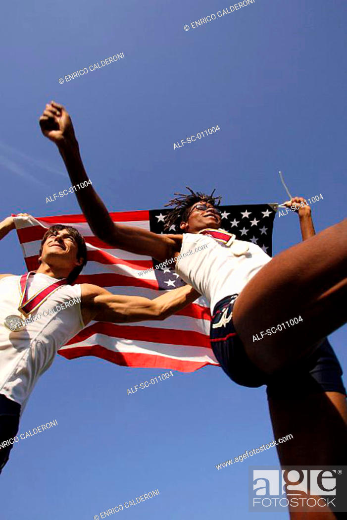 Stock Photo: Male Runners Carrying US Flag.