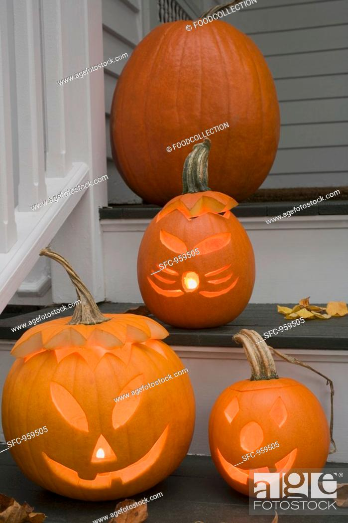 Stock Photo: Pumpkin decorations for Halloween on stairs.