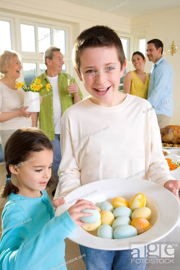 Stock Photo: Boy and girl with bowl of Easter eggs.