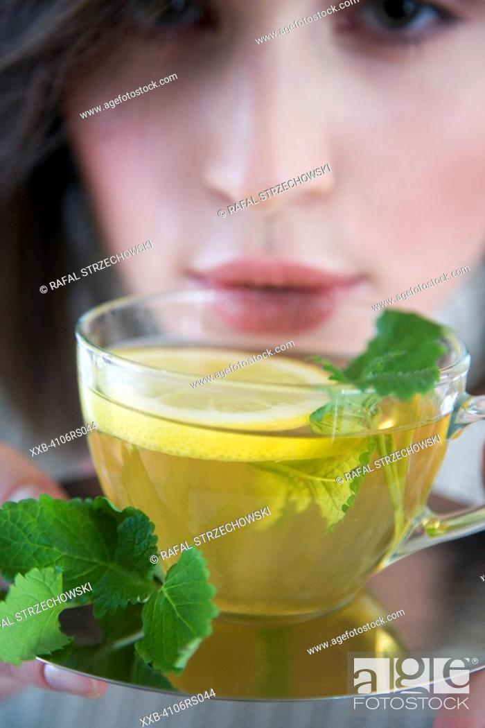 Stock Photo: woman with mint & lemon tea.