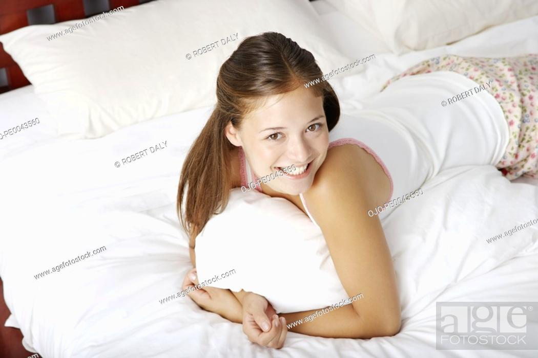 Stock Photo: A young woman lying in bed.