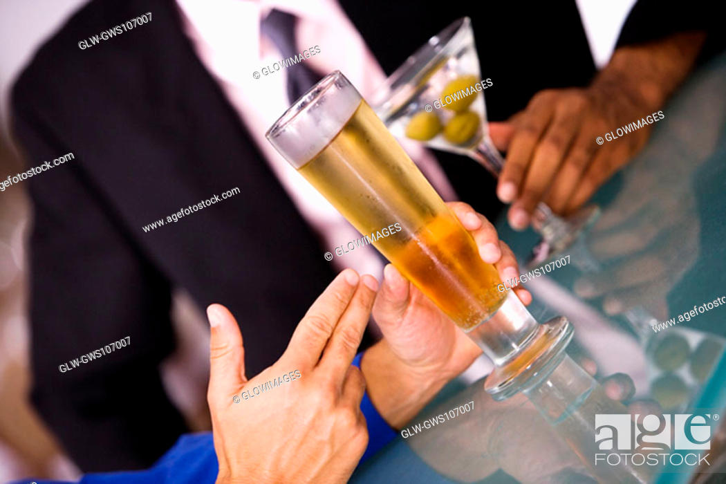 Stock Photo: Close-up of a businessman seated at a bar counter.