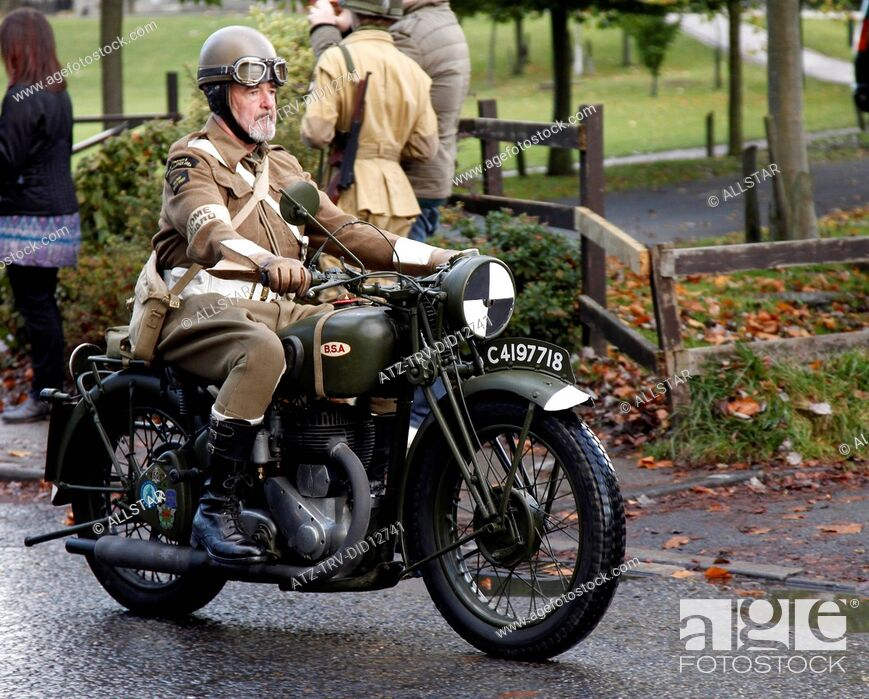 Stock Photo: HOME GUARD RIDER ON BSA MOTOR CYCLE; PICKERING, NORTH YORKSHIRE; 16/10/2010.