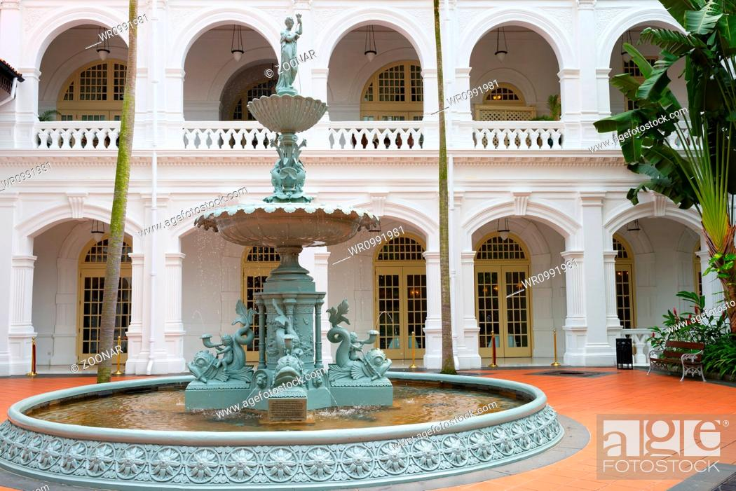 Stock Photo: Fountain in classical colonial style, Singapore.