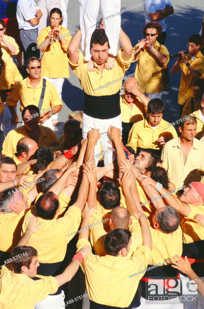 Stock Photo: 'Castellers' human towers builders, a Catalan tradition. Sant Pere de Ribes. Barcelona province, Spain.