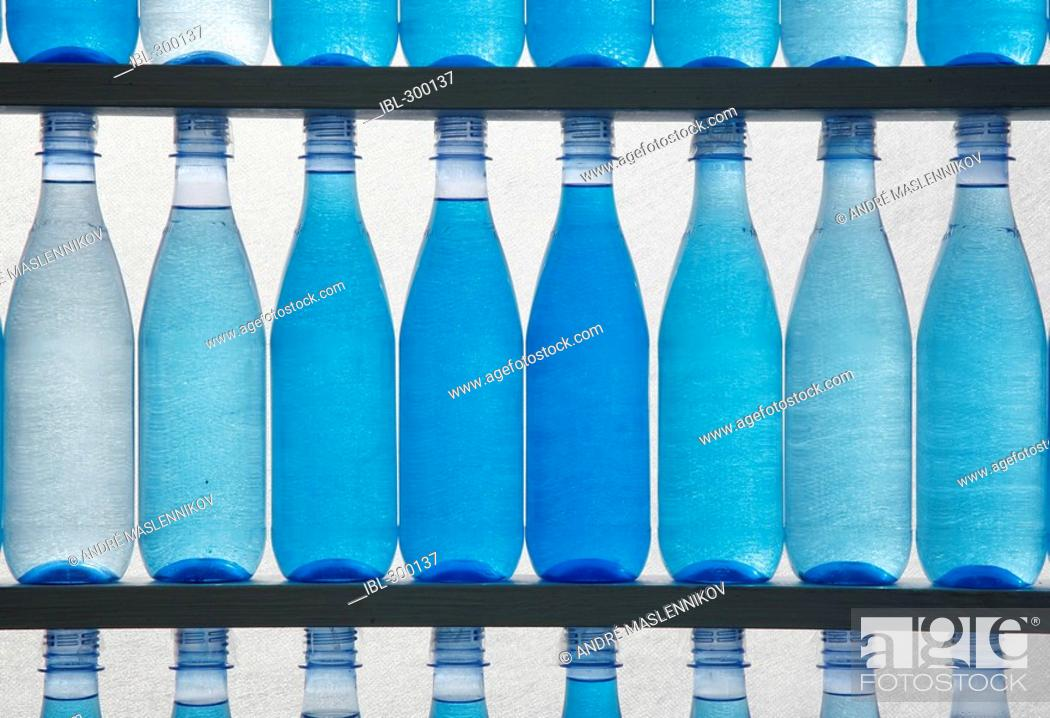 Stock Photo: Bottles filled with water.