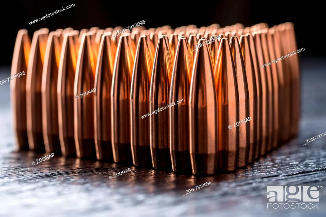 Stock Photo: Macro shot of copper bullets that are in many rows to form a triangle.