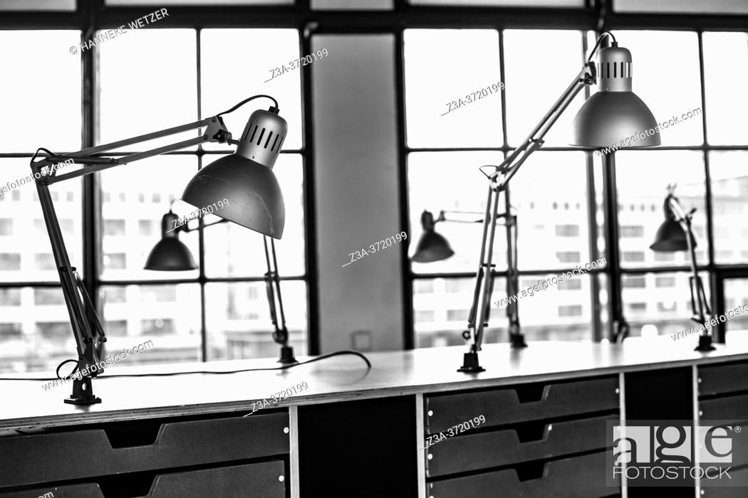 Imagen: Lamps attached to a chest of drawers in restaurant Keukenconfessies at Strijp-S, Eindhoven, The Netherlands, Europe.