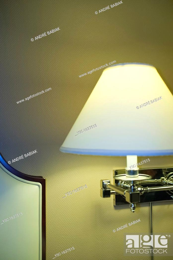 Stock Photo: Hotel room lamp shade next to bed.