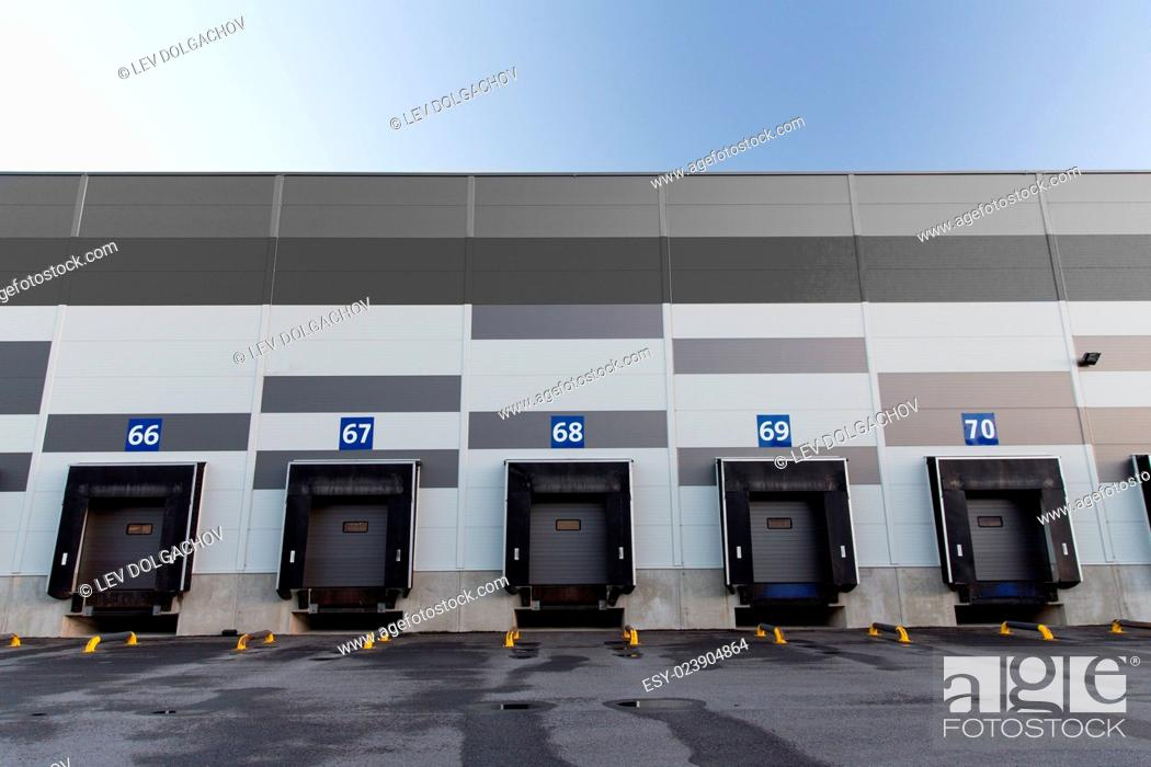 Stock Photo: logistic, storage and shipment concept - warehouse gates.